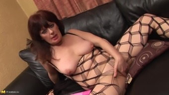 Seasoned Girl In Fishnet Clothing And Her Proclivity For The Pink Dildo