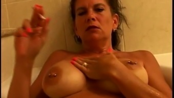 Warm Busty Mature Cougar Smoking Cigarettes Or Cigars 120s In Bathtub