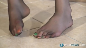 A Girl In Nylons Enhance Her Ridiculous Painted Toes And Feet